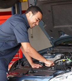 Mechanic Working on Car - Auto Repair